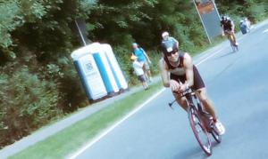 David just behind Hans on Heartbreak hill and still laughing and chasing the Ironmanfinish