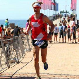 Sam running a sub 3h marathon in Ironman South Africa